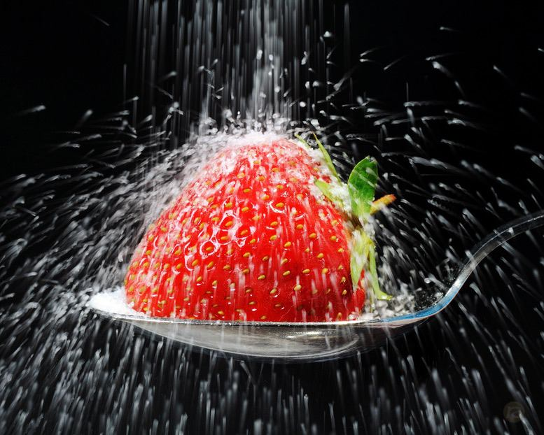 sugar coated strawberry on spoon